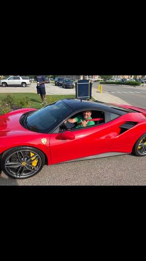 Mike Brey arrives at Rolfs Hall in a Ferrari
