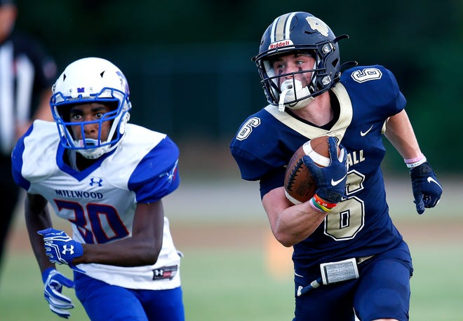 Oklahoma City Heritage Hall's Gavin Freeman, right, makes tracks during the Chargers' season-opening 44-18 victory Sept. 2 against Oklahoma City Millwood. Freeman, a receiver and return man, made an oral commitment Saturday to Texas Tech.