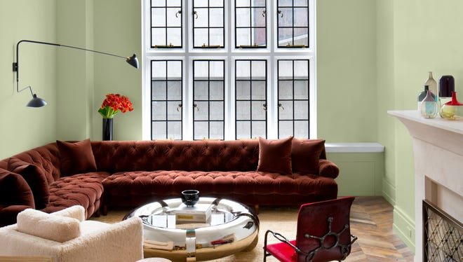 """PPG's Color of the Year is Olive Sprig, """"an elegant, grounded, versatile and highly adaptable grey-green"""" featured here alongside other on-trend colors retro red and creamy beige."""
