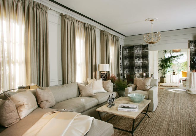 In the hands of a skilled designer who understands texture and contrast, a neutral color scheme can appear calming and elegant. The Palm Beach design team at William R. Eubanks Interior Design Inc. chose a gray sectional sofa for a living room decorated several years ago in an American Red Cross Designers Show House.
