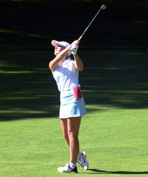Petoskey's Aubrey Williams follows her approach during Thursday's round, where she medaled with an 82.