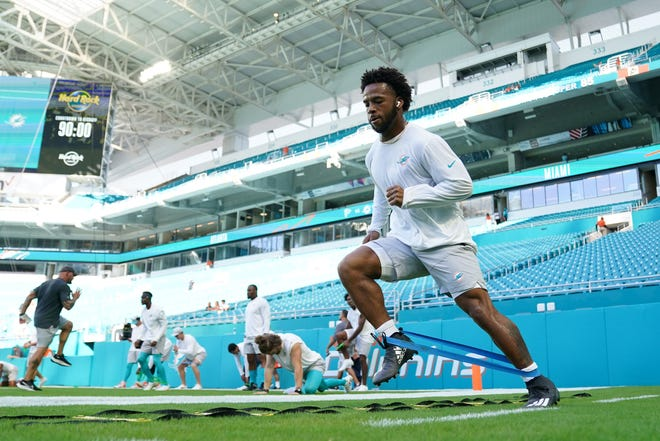 Aug 21, 2021; Miami Gardens, Florida, USA; Miami Dolphins running back Myles Gaskin (37) warms up prior to the game against the Atlanta Falcons at Hard Rock Stadium. Mandatory Credit: Jasen Vinlove-USA TODAY Sports