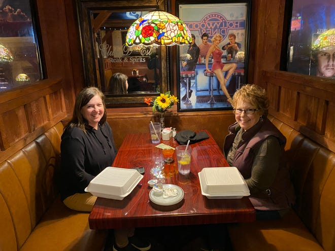 Club D'Est customers Michell Welch and Linda Pentz enjoy the atmosphere after a good lunch at the Pratt restaurant.