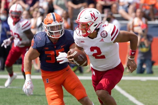 Nebraska quarterback Adrian Martinez is chased down by Illinois linebacker Jake Hansen during last week's game, won by the Illini, 30-22.
