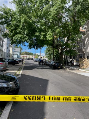 Police tape on Richter Street, in Providence, on Friday afternoon.