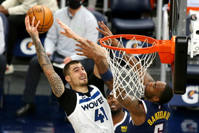 Timberwolves forward Juancho Hernangomez goes in for a slam dunk during a game against the Nuggets in January. On Friday, he was traded to the Celtics.