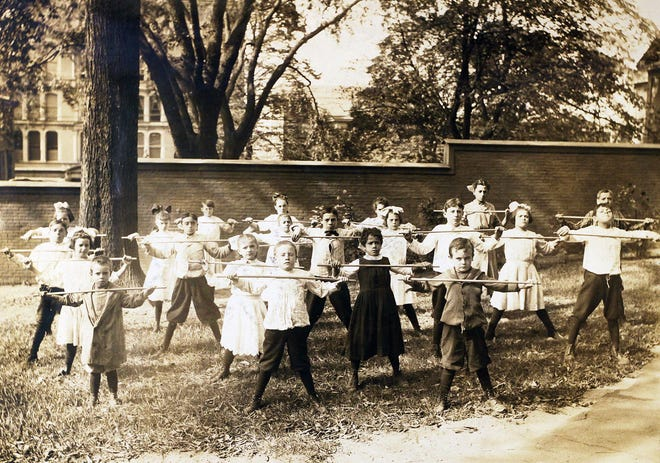 In this undated photo, children do exercises outdoors at the Meeting Street School in Providence.