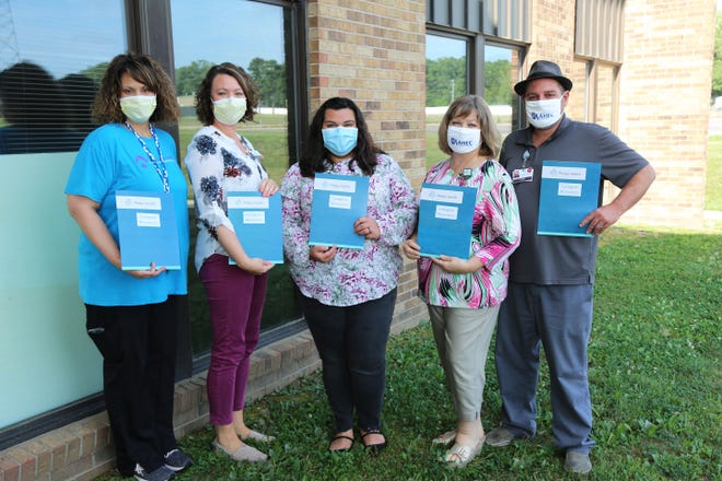 From left are Beth Geoit and Natalie Turnbough, Phelps Health care managers; Meghan Casteel, Phelps Health patient access resource coordinator; Susan Bowles, health careers coordinator with Mid-MO AHEC; and Franz Kindel, student education coordinator with Mid-MO AHEC.