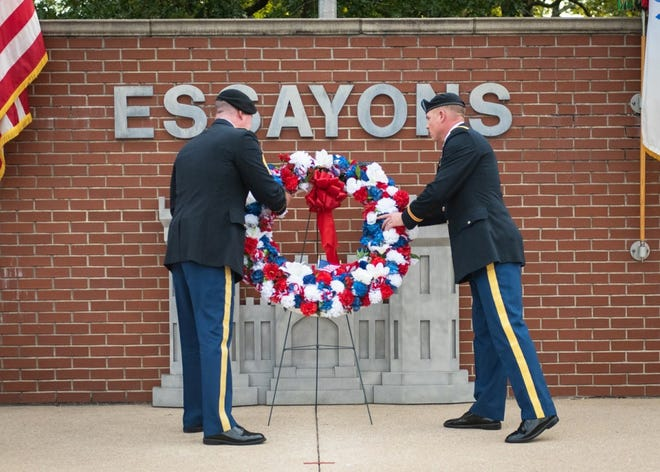 Col. Daniel Hibner, U.S. Army Engineer School commandant (right), and USAES Command Sgt. Maj. John Brennan lay a wreath at the Engineer Memorial during the Fallen Sapper Tribute ceremony Aug. 26 at Memorial Grove. The event was part of Engineer Regimental Week, which took place from Aug. 23 to 27. Photo by Stephen Standifird, Fort Leonard Wood Public Affairs Office