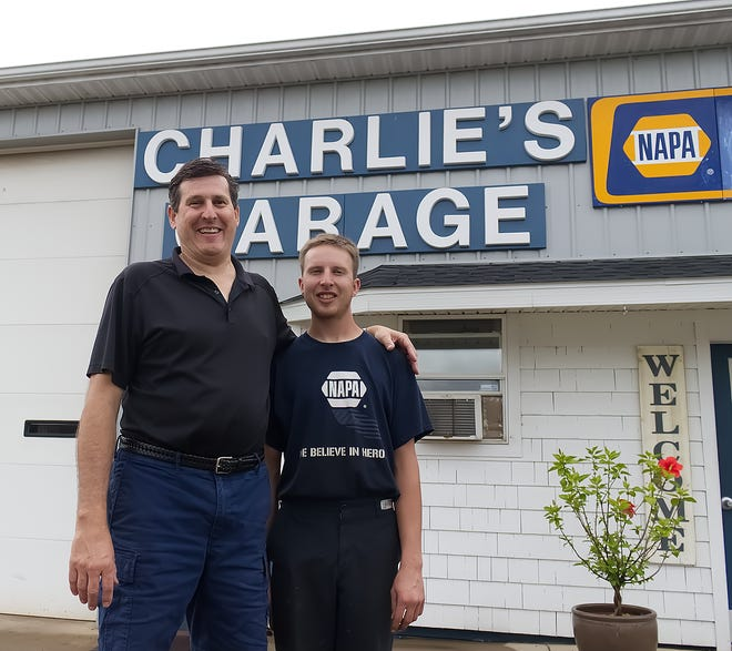 Terry Chitty, left, and his son, Scott both work at Charlie's Garage, which this year celebrates its 40th anniversary.