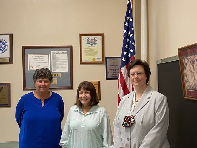Candi Lukat, right, has been named treasurer of the Ravenna School District. From left are Dr. Laura Hebert, superintendent; Joan Seman, president of the Board of Education, and Lukat.