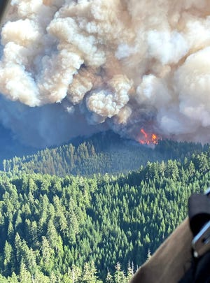 The Middle Fork Complex's Gales Fire is seen from the air  Aug.16 burning in the Fall Creek drainage area. As the fire burned into heavy fuels it created a column visible in surrounding communities.