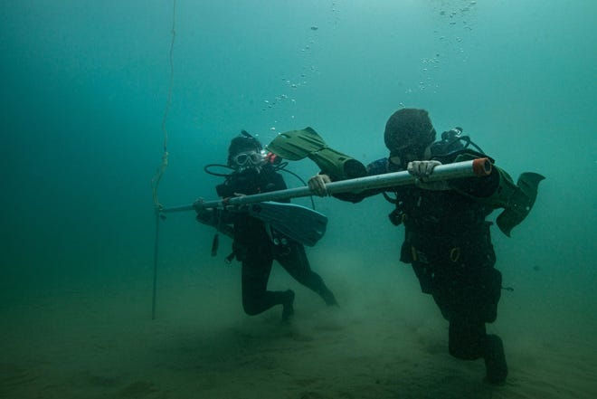 Divers with Indiana University's Center for Underwater Science set a buoy in Lake Michigan this summer to mark the shipwreck site of the Muskegon.