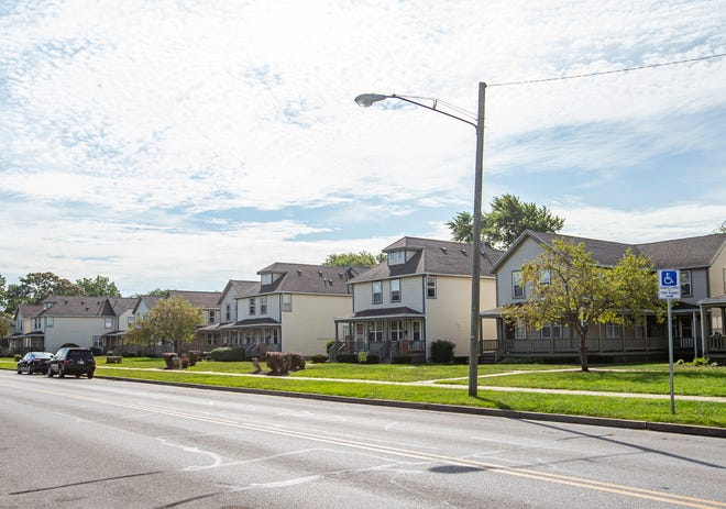 A row of homes along West Washington Street in South Bend has few trees on Friday. The city seeks to remedy that by planting 40,000 trees throughout the city by 2050.