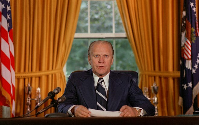 """President Gerald Ford reads a proclamation in the White House on Sept. 8, 1974 granting former President Richard Nixon """"a full, free and absolute pardon"""" for all """"offenses against the United States"""" during the period of his presidency."""