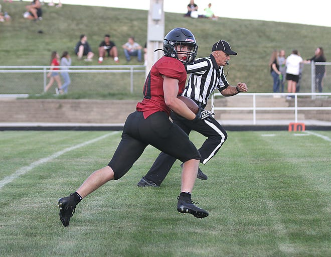 White Pigeon's Jack Davidson breaks free for a 33-yard touchdown against Galesburg-Augusta on Thursday.