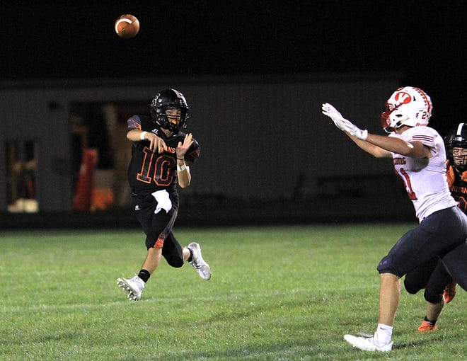Sturgis quarterback Taner Patrick throws on the run against Vicksburg in prep football action on Thursday.