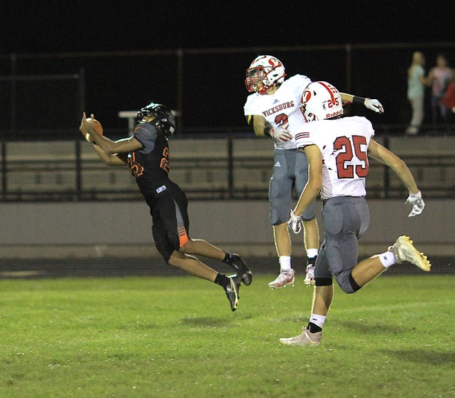 Jacob Thompson hauls in a catch for a big gain in the third quarter on Thursday night.