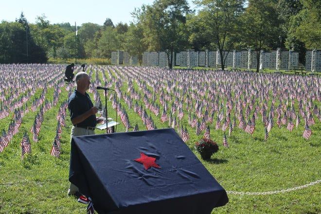 Patriot Park Foundation President Randy Musser speaks Friday during the dedication of the global war on terrorism memorial.