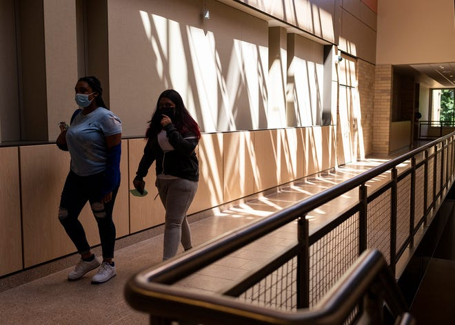 Students walk through the halls of the new South High on Friday.