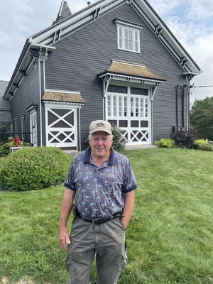 Blissful Meadows Golf Club owner Gordon Bliss in front of the clubhouse.