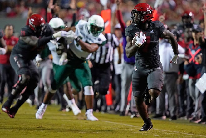 North Carolina State running back Zonovan Knight runs for a touchdown against South Florida during the second half of an NCAA college football game in Raleigh, N.C., Thursday, Sept. 2, 2021.