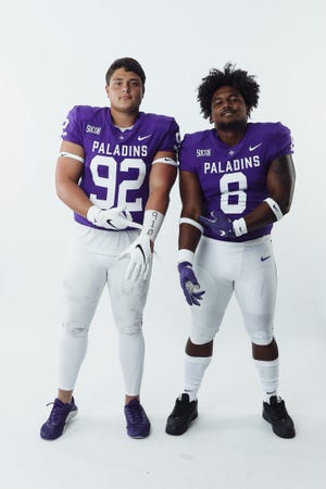 Pine Forest's Matthew Sochovka (92), pointing to the 910 inscription on his forearm, and Dominic Roberto (8) continue to thrive as teammates on the Furman football team.