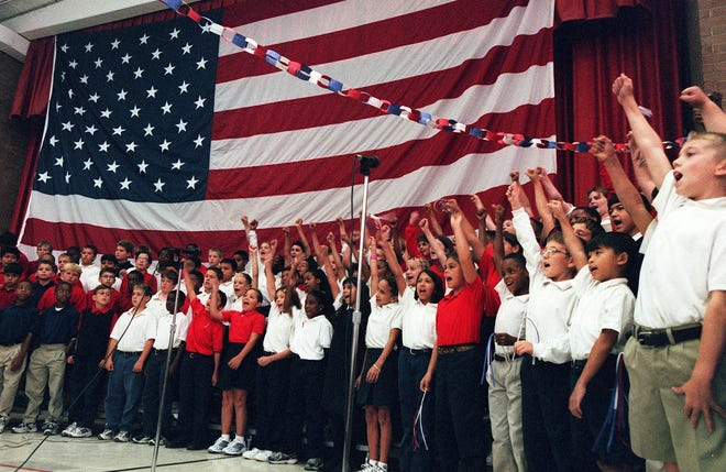 Students at Irwin Middle School on Fort Bragg sing during their patriotic program, Friday, Sept. 28, 2001.