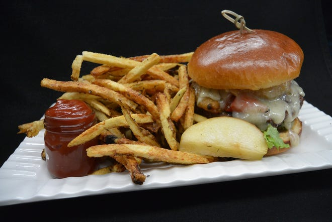 A cheeseburger and fries from The Table restaurant in Montgomery.