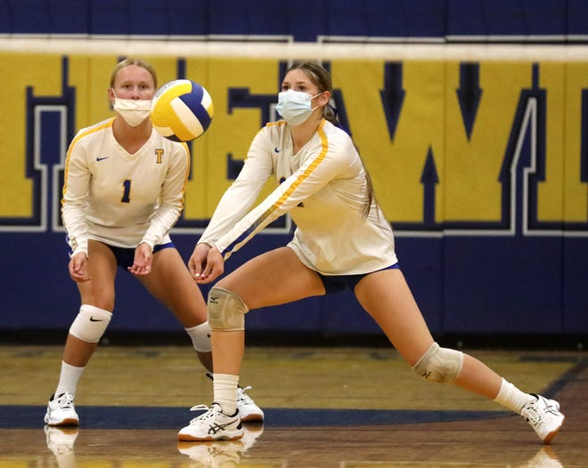 Cadence Mizener receives serve in front of Cambria Parker