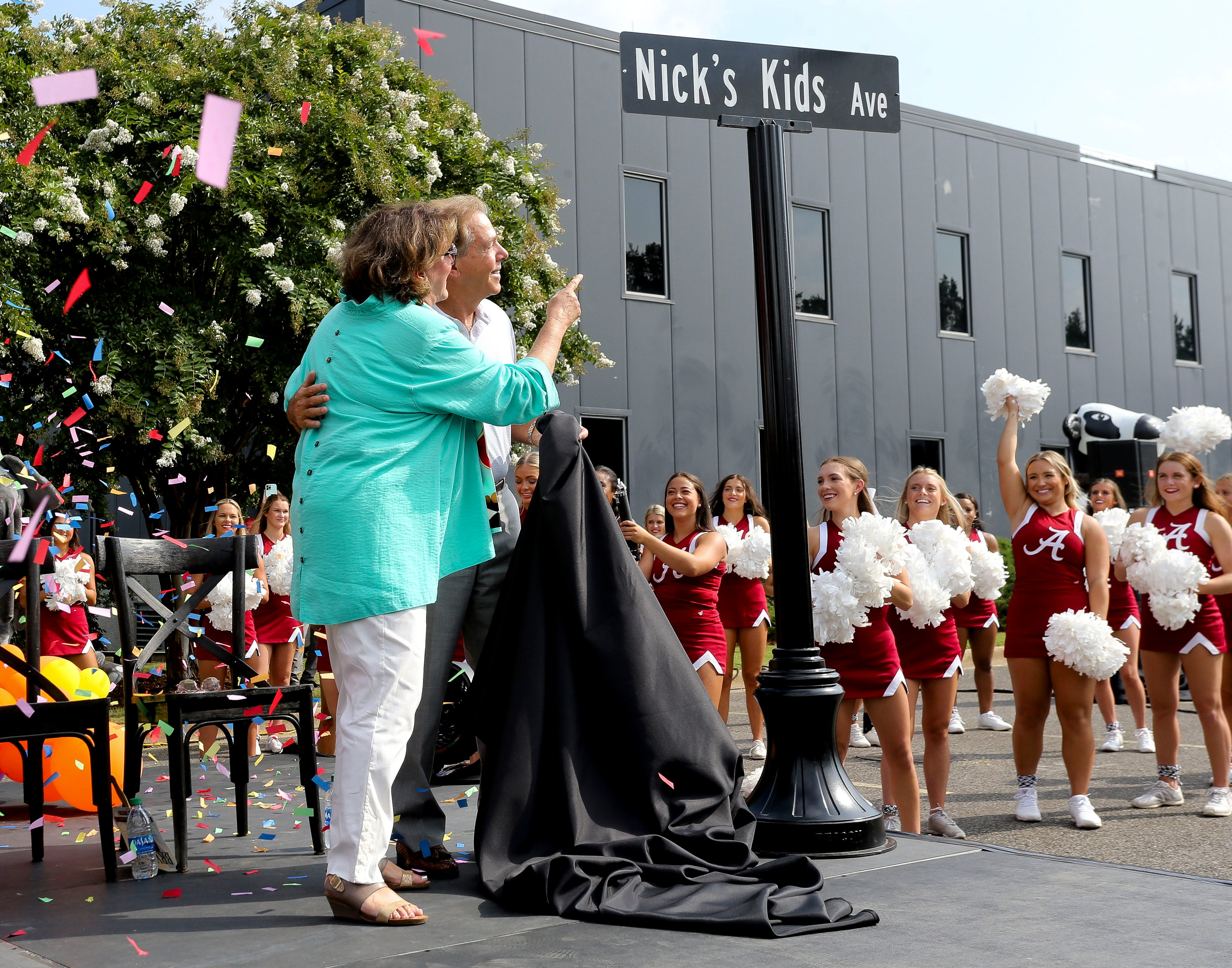 The City of Tuscaloosa renamed 28th Avenue as Nick's Kids Avenue Thursday, Aug. 5, 2021. Terry and Nick Saban enjoy the moment after they have unveiled the street sign. [Staff Photo/Gary Cosby Jr.]