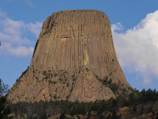 Devils Tower in Wyoming rises more than 1,000 feet above the Belle Fourche River.