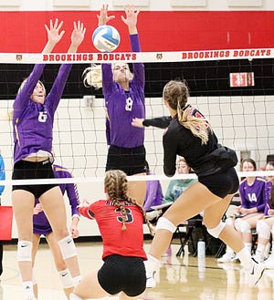 Watertown's Eve Hauger (6) and Emily Tisher (8) go up for a block during their high school volleyball match at Brookings on Thursday. The Arrows outlasted the Bobcats in five sets