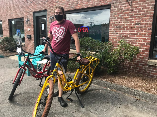 Edward O'Neil, the manager of Pedego in Lexington, described himself as a pedal biking purist before converting to electric bikes.