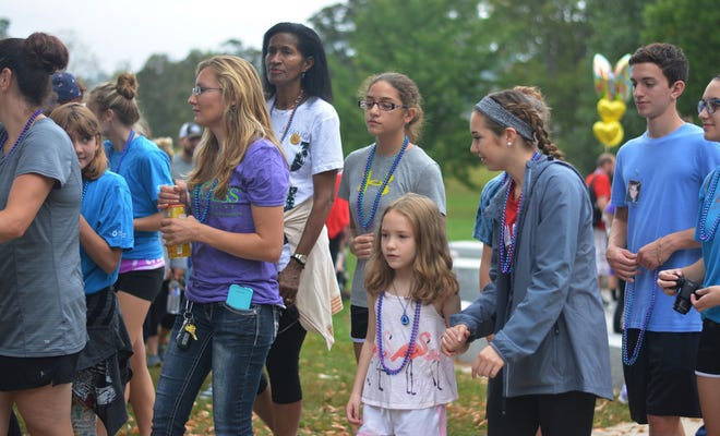 """Walkers during the """"Out of the Darkness"""" walk at Institute Park, Worcester, September 16, 2017. [Photo/Jessica Picard]"""