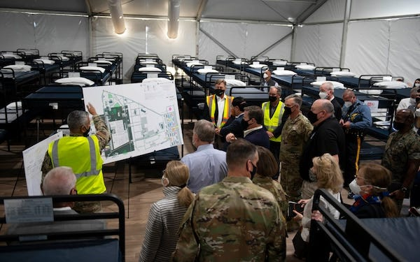 Military and elected officials tour the facilities housing and supporting Afghan evacuees at Joint Base McGuire-Dix-Lakehurst.