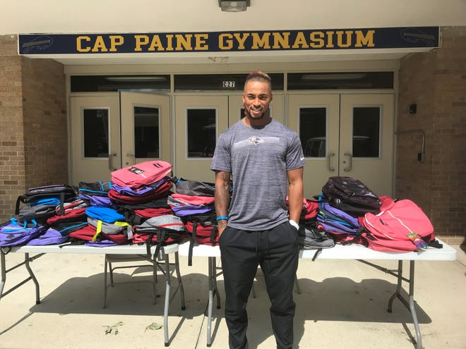 Woodbury High School alum and Baltimore Ravens defensive back Anthony Averett returned to his alma mater on Friday for his school supply giveaway for the kids in the town. He was also named an honorary game captain for the football team.
