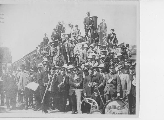 John Huhlein's band with a sign indicating it was playing at the sale of lots in North Parkland subdivision in the early 1900s. Charles F. Kleiderer developed Parkland subdivision -- roughly bordered by Elm, Green, 12th and 14th streets -- in 1905, doubling the city's system of concrete sidewalks. He later developed North Parkland, which was to the north of his previous subdivision. In 1946-47 there was much controversy whether North Parkland should be annexed. When it finally happened at the end of 1947 the annexed area included all of Atkinson Park. (Photo courtesy Henderson County Public Library)