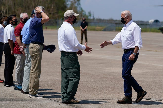 President Joe Biden greets Louisiana Gov. John Bel Edwards as he arrives at Louis Armstrong New Orleans International Airport in Kenner, La., Friday, Sept. 3, 2021, to tour damage caused by Hurricane Ida. Watching from left are Jefferson Parish President Cynthia Lee Sheng, New Orleans Mayor LaToya Cantrell, Rep. Steve Scalise, R-La., Sen. John Kennedy, R-La., and Sen. Bill Cassidy, R-La. (AP Photo/Evan Vucci)
