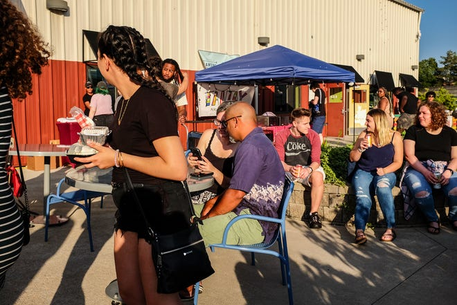 People attend the Afterglow Market and wait for the entertainment to start Friday, Aug. 13, 2021.
