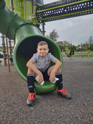 Adrian Serrano Jr., 10, returned to Village Park in Sussex to scrub obscene graffiti he saw inside the slide. He wants others to let them know if they see graffiti, so he can clean it up.