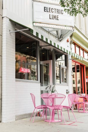 With pink chairs and tables on the sidewalk, Electric Lime Taqueria is open at 730 N. Milwaukee St. The awning pays tribute to the Heinemann's restaurant that once occupied the building.