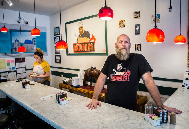 Owner Chris Divine at his restaurant Bazooky's on the location's final day before closure Friday, Sept. 3, 2021. Divine said the difficulty he had finding and retaining employees contributed to his diner's closure.