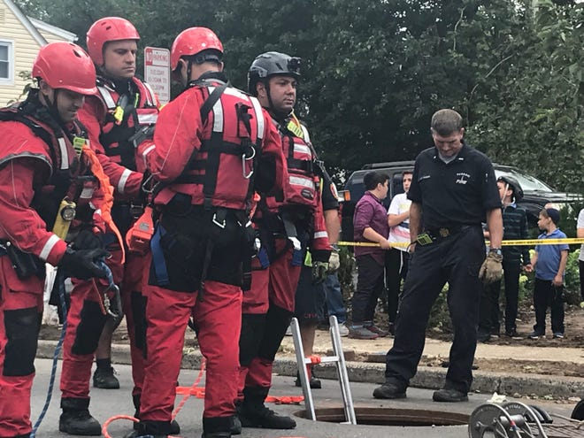 Responders continue to search Sept. 3, 2021 for a pair that went missing and swept away by floodwaters in Passaic during the storm caused by Hurricane Ida.