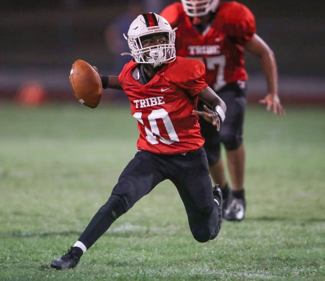 Palm Springs quarterback Jayvyn Capler cuts and picks up a first down against Eisenhower during the Indians win, September 2, 2021.