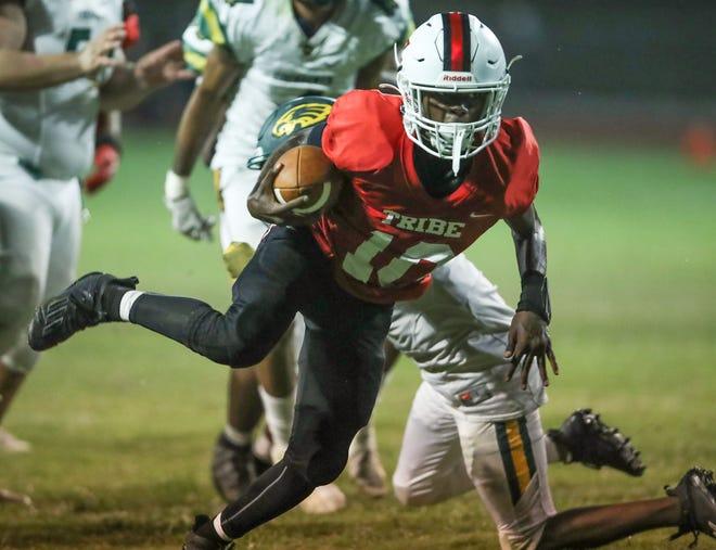 Palm Springs quarterback Jayvyn Capler gets into the end zone for a touchdown against Eisenhower, September 2, 2021.