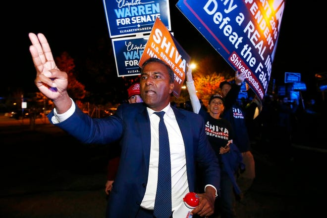 Independent candidate for U.S. Senate from Massachusetts Shiva Ayyadurai protests being excluded from a debate between Sen. Elizabeth Warren and her Republican opponent Geoff Diehl in Boston in 2018. Ayyadurai has been hired by the Arizona Senate to conduct itsreview ofvoter signatures on mail-in ballot envelopes in Maricopa County.