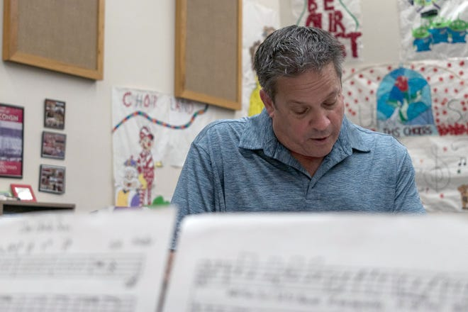 """Geoff Hutter, the choir teacher at Ironwood High School, talks about the lyrics of his song, """"Dear Uncle Sam,"""" which commemorates 9/11, Sept. 1, 2021, in Glendale."""