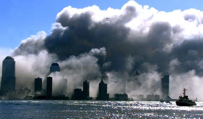 Sept 11, 2001; Jersey City, NJ, USA; Photos taken on 9/11 of the terrorist attacks that brought down the World Trade Center Twin Towers.  Photos taken from Exchange Place in Jersey City, just across the Hudson River from the WTC. Mandatory Credit: Thomas E. Franklin-USA TODAY NETWORK