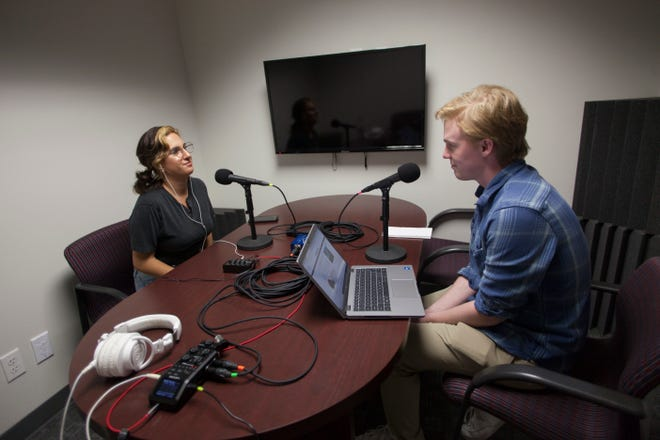 The Spectrum's Elle Cabrera, left, interviews reporter Sean Hemmersmeier about his recent work regarding the discovery of an apparent cemetery holding a dozen children who were kept at a former Indian residential home in Panguitch, Utah.